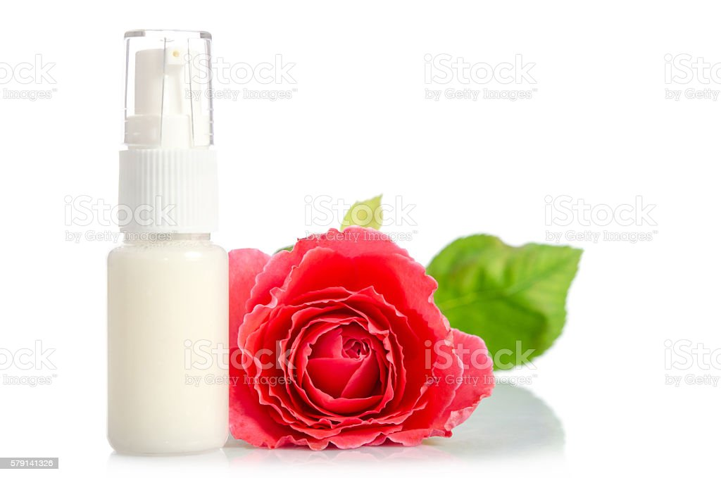 Face cream bottle with pink rose stock photo