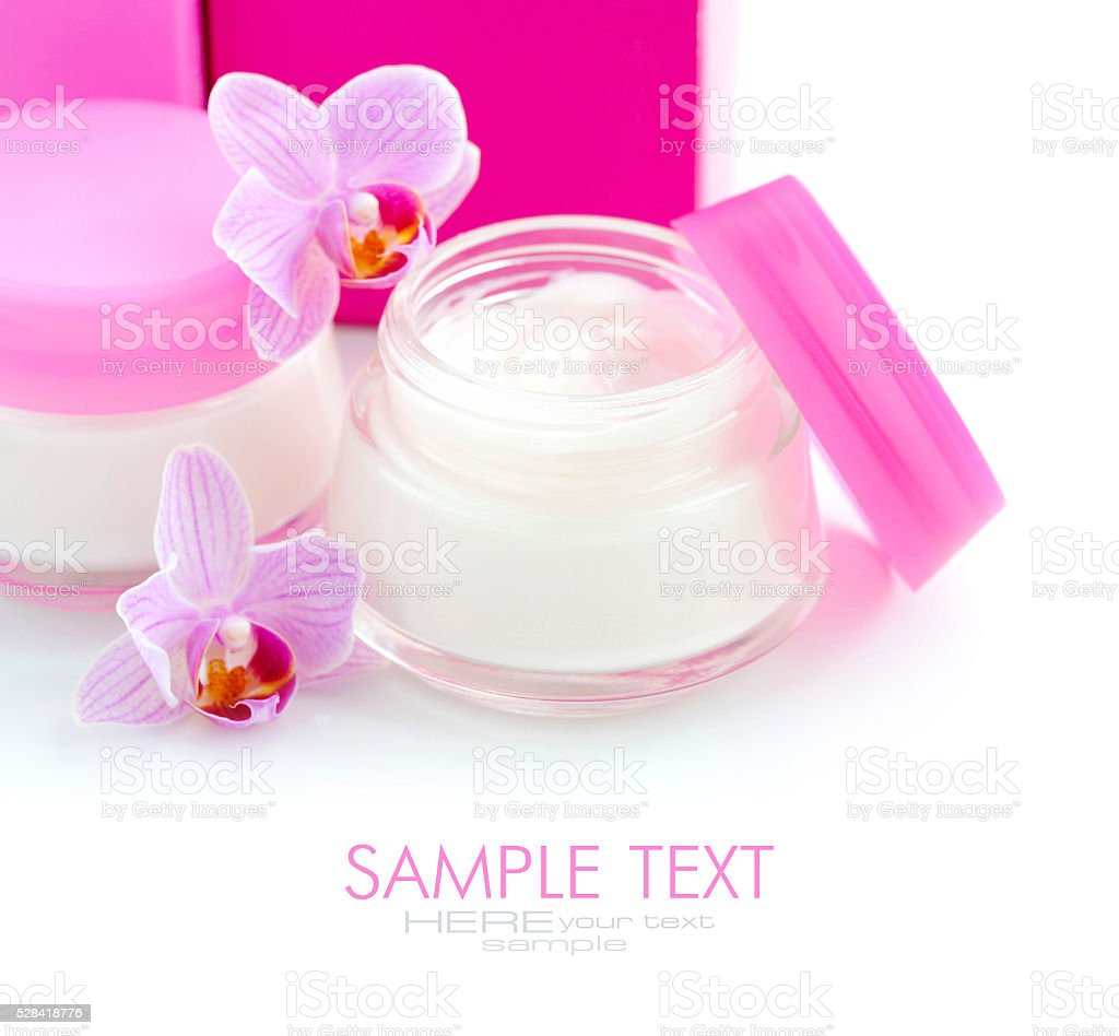 Face creams and beautiful orchid flowers on white background stock photo