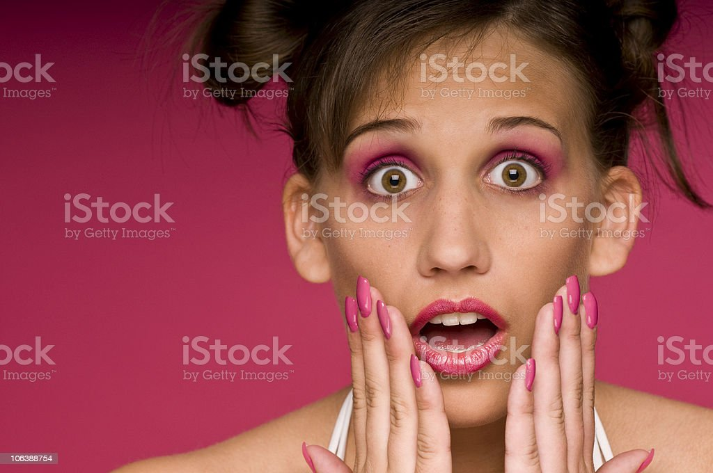 Face expressions series - Beautiful woman in pink royalty-free stock photo