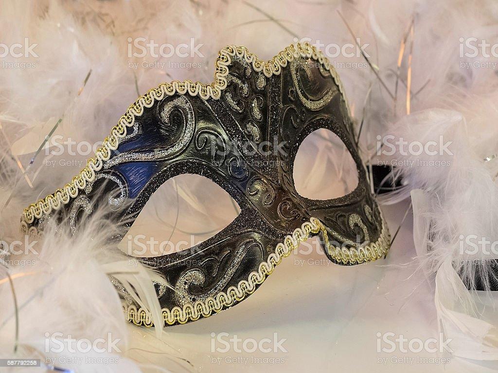 face, eye mask, feather boa, colored stock photo