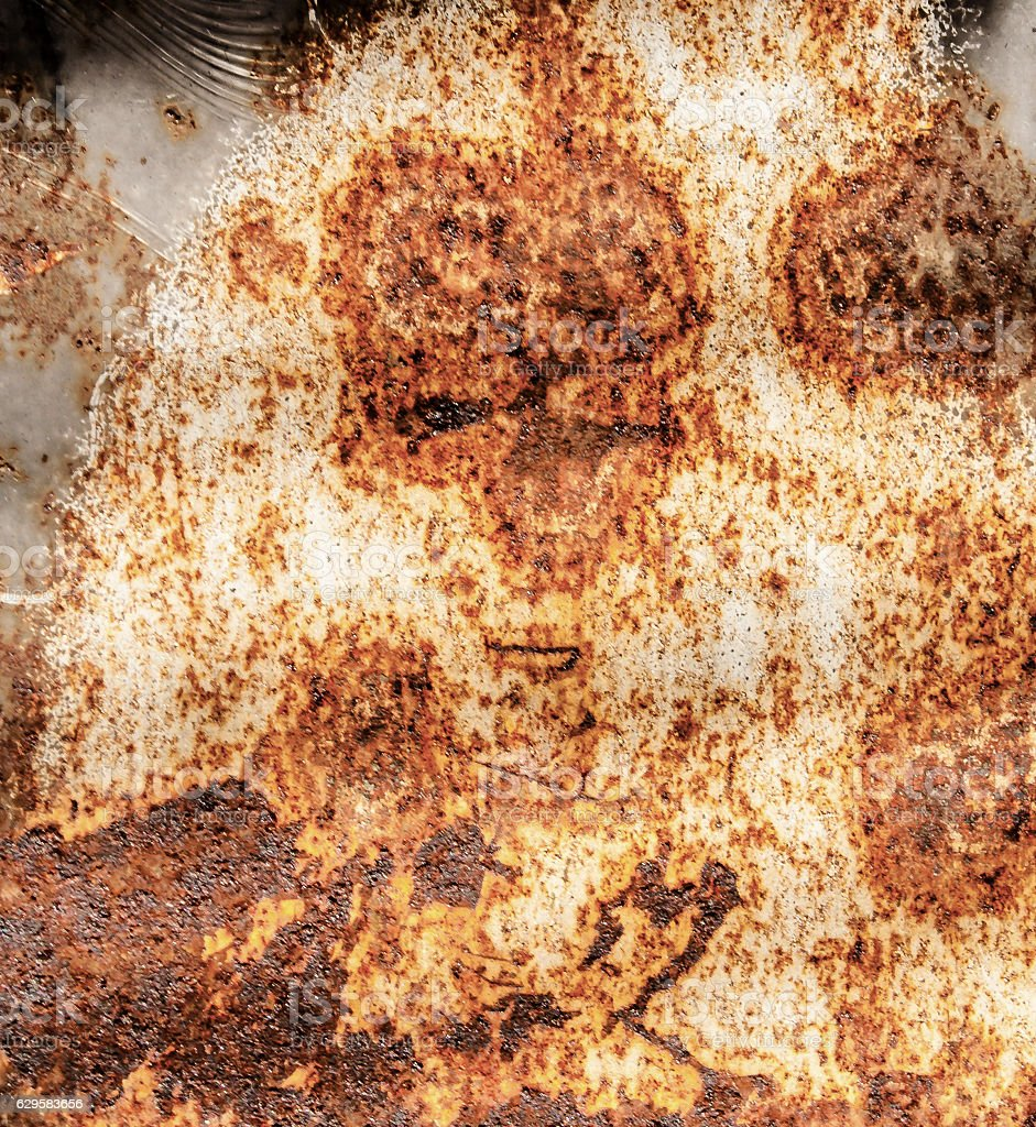 Face in a Rusty Metal Sheet (pareidolia) stock photo