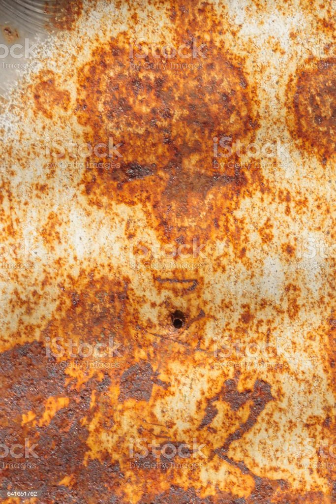 A face in rusty metal stock photo