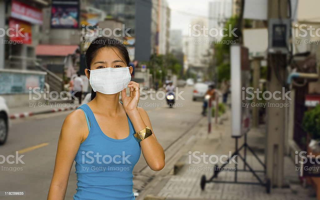 face mask in the streets of bangkok royalty-free stock photo