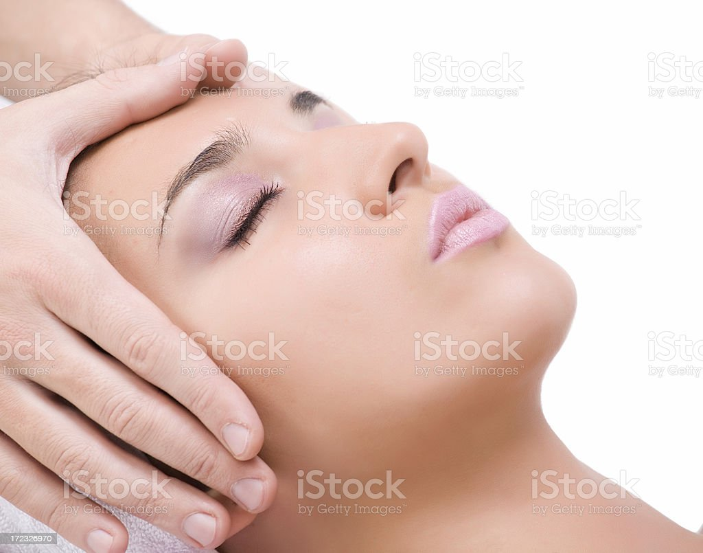 Face massage of woman isolated on white royalty-free stock photo