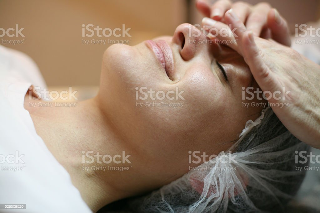 Face massage. stock photo
