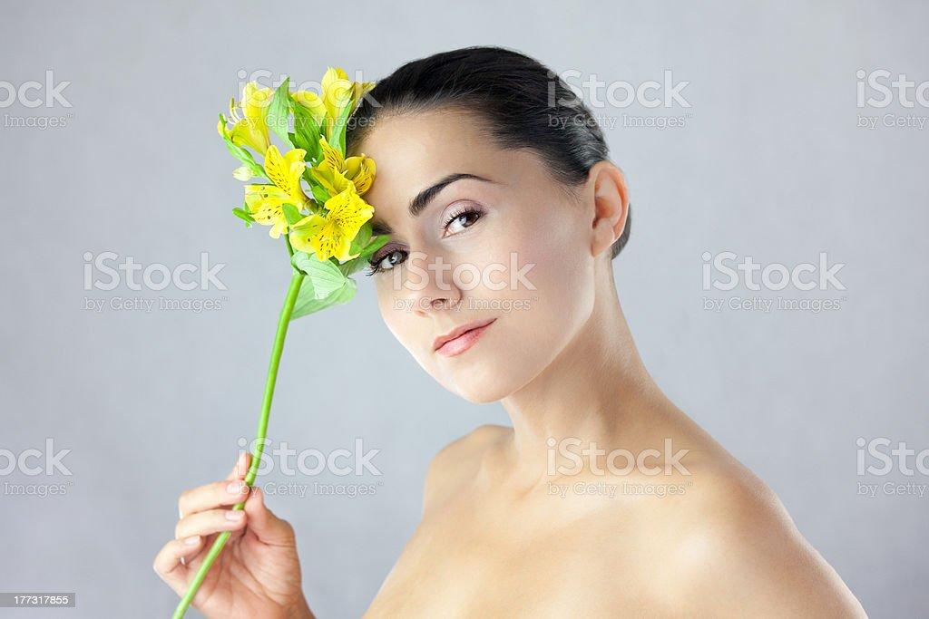 Face of a beautiful woman with flower royalty-free stock photo