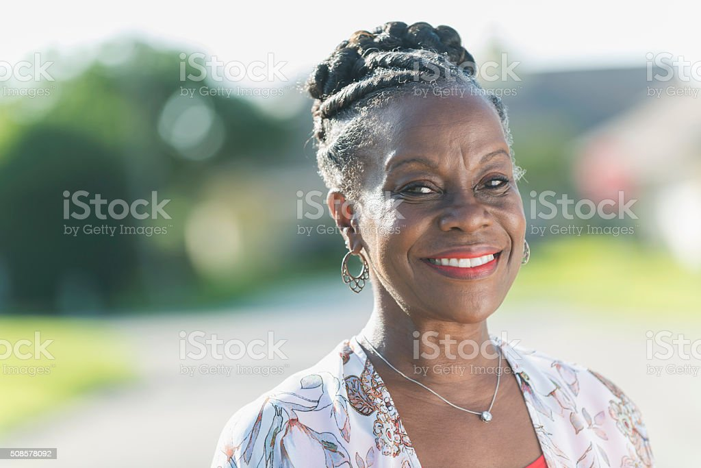 Face of a mature African American woman outdoors stock photo