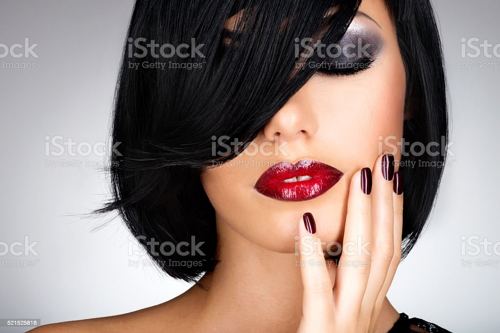 Face of a woman with beautiful dark nails and sexy stock photo