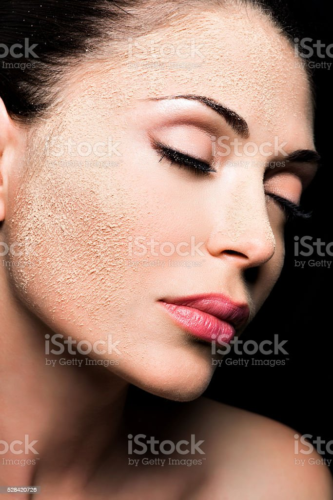 Face of a woman with cosmetic powder on skin stock photo