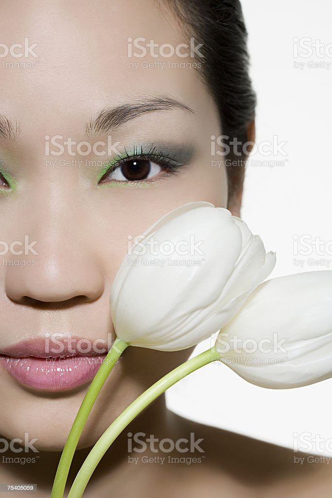 Face of a woman with tulips royalty-free stock photo