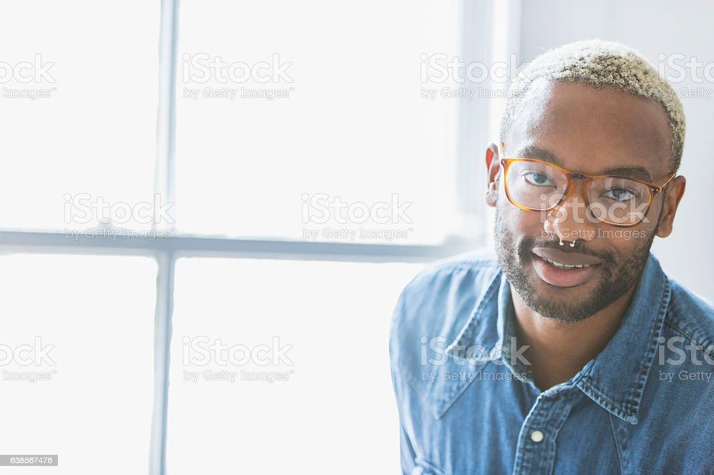 Face of a young black man with nose ring stock photo