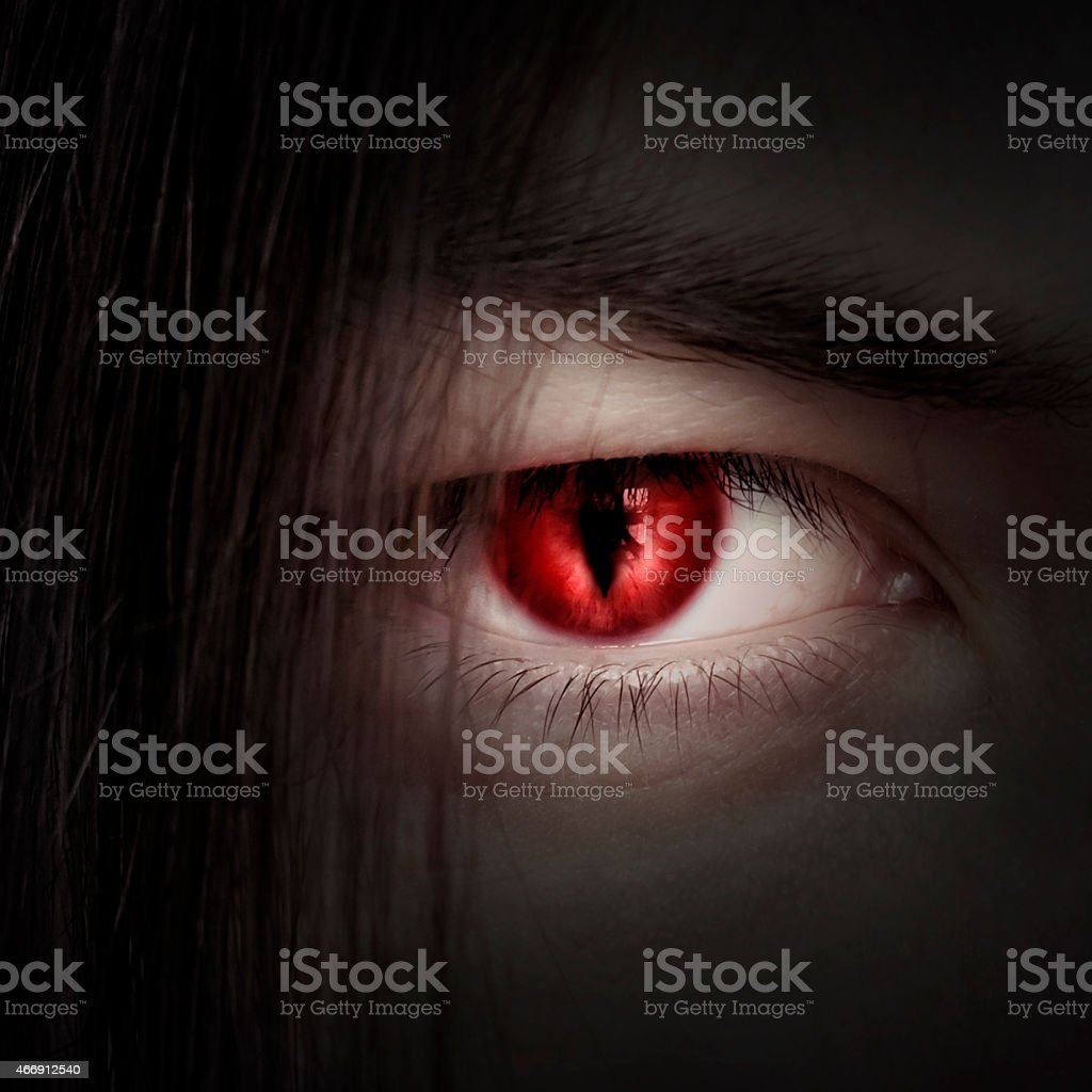 face of a young male vampire close up stock photo