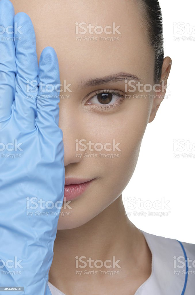 Face of a young woman partially covered hands royalty-free stock photo