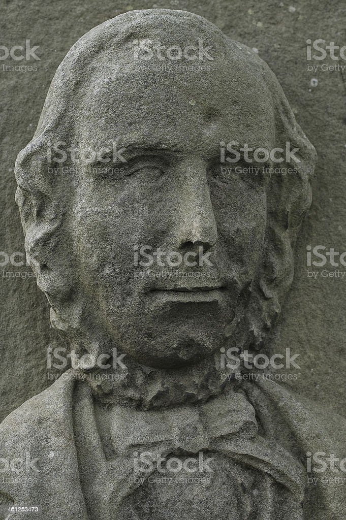 Face of an 18th century English lord engraved on stone royalty-free stock photo