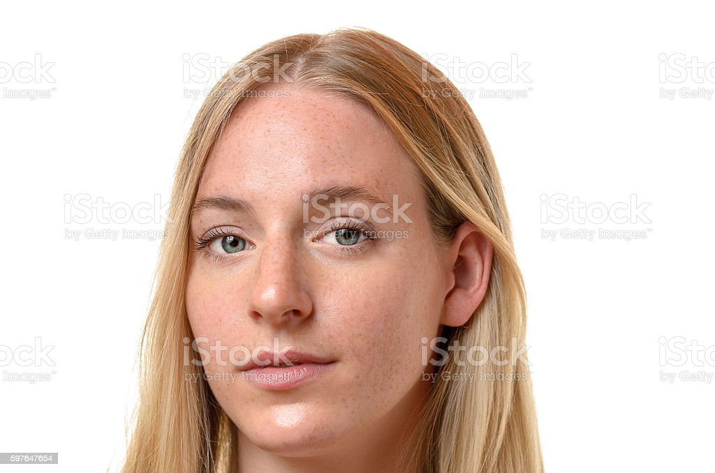 Face of an attractive serious blond woman stock photo
