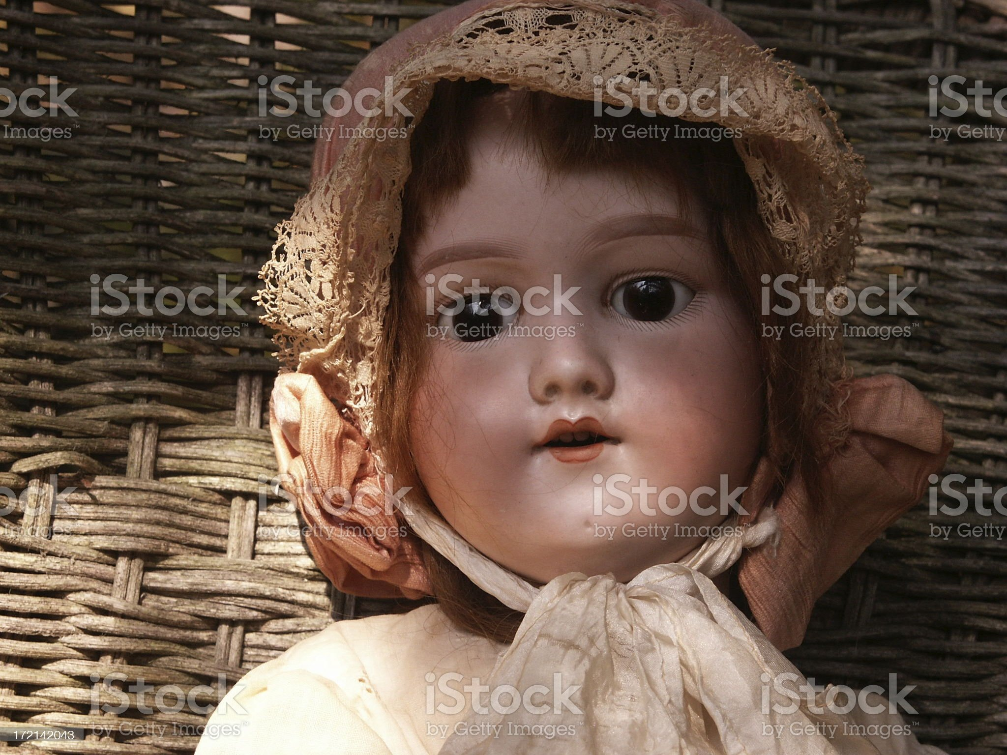 Face of and Antique Doll in Autumn Shadows royalty-free stock photo
