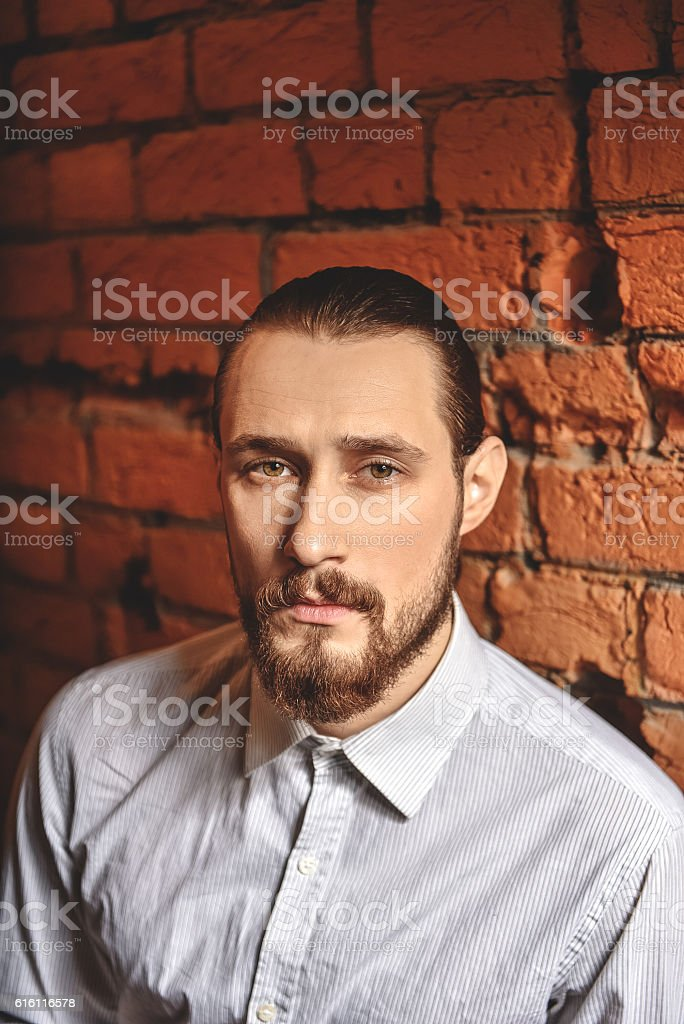 face of artisan over brick wall stock photo