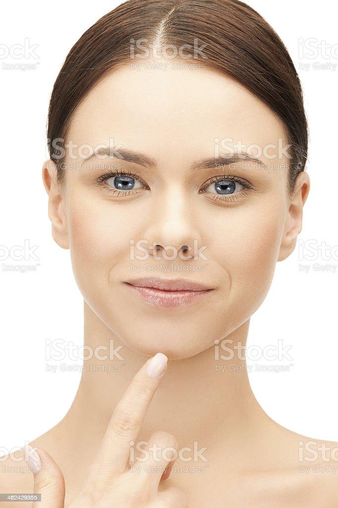 face of beautiful woman touching her chin stock photo
