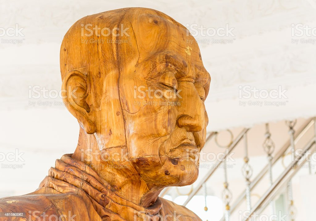 Face of Buddha carved wood. stock photo