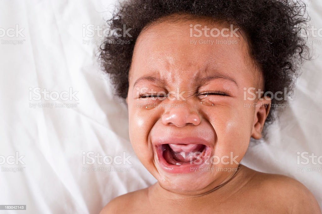 Face of crying African American baby royalty-free stock photo