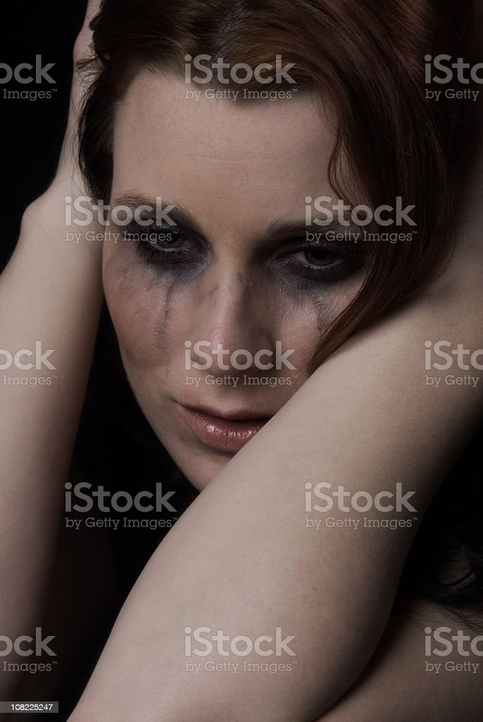 Face of dispair, sad woman with tears and smeared makeup stock photo