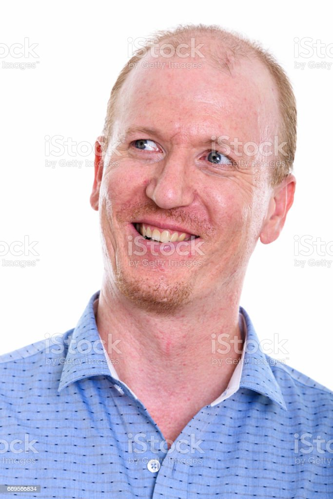 Face of happy businessman smiling while thinking and looking up stock photo