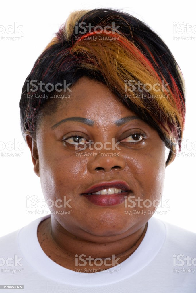 Face of happy fat black African woman smiling while thinking ready for gym stock photo