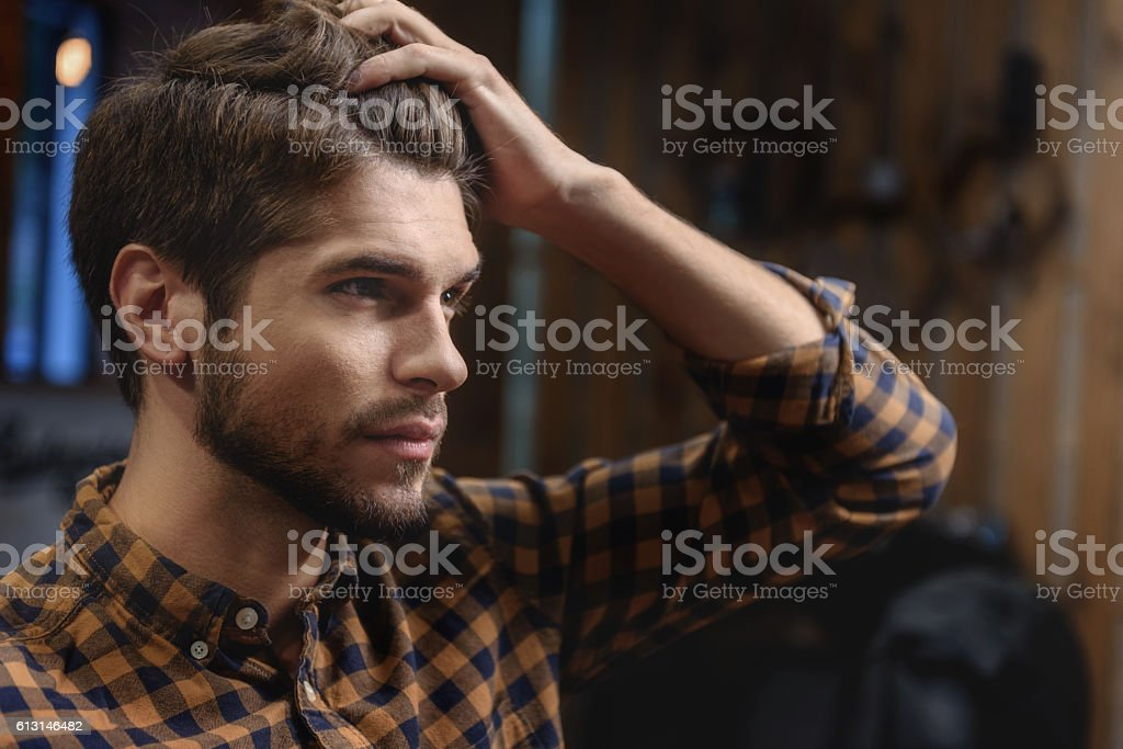 face of male client visiting hairstylist stock photo