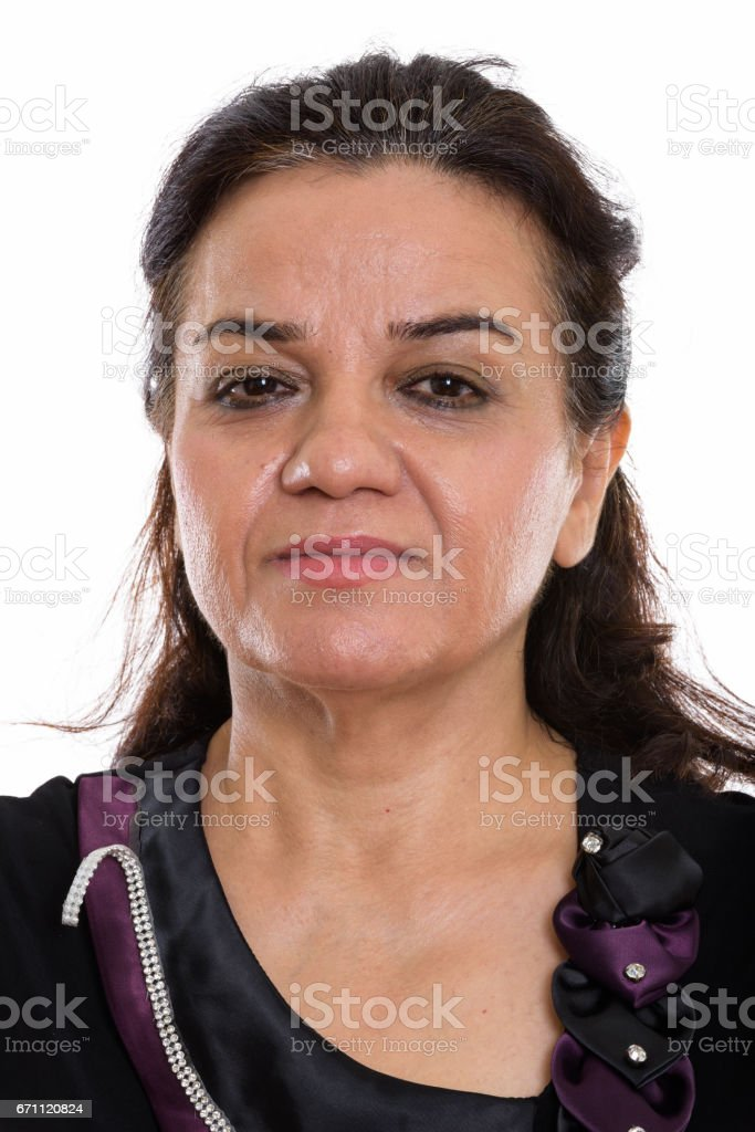 Face of mature Persian woman with hair tied stock photo