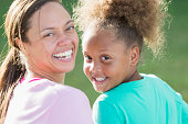 Face of smiling 7 year old African American girl