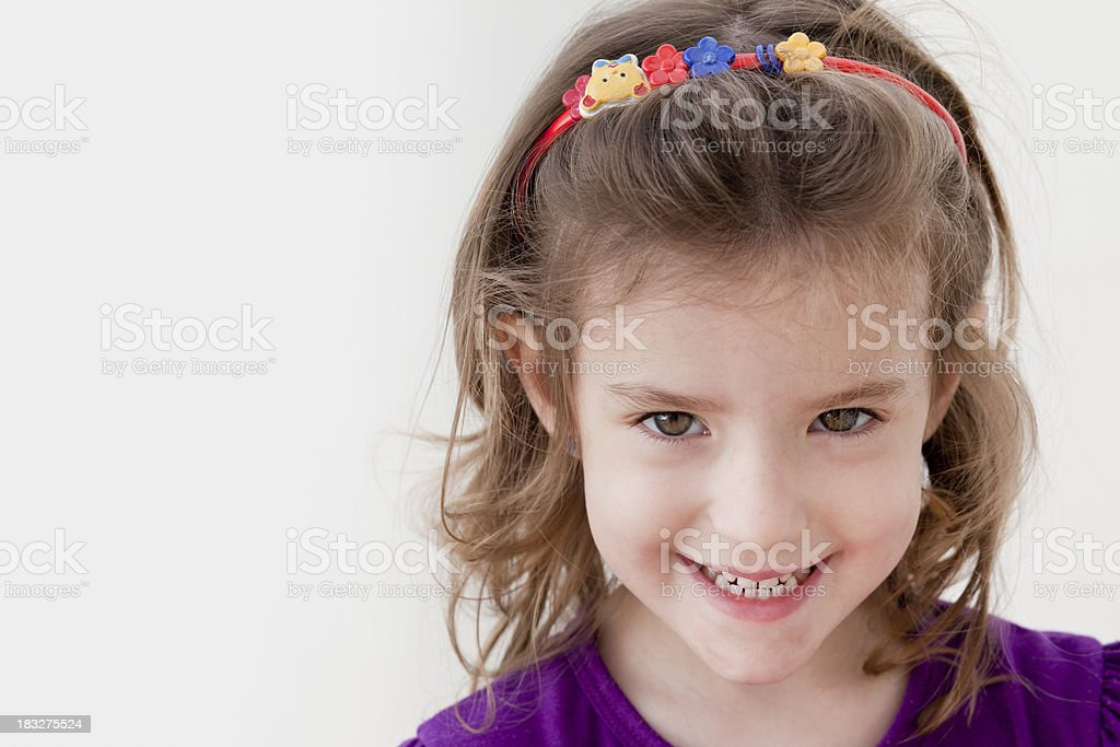 Face of smiling little blonde girl stock photo