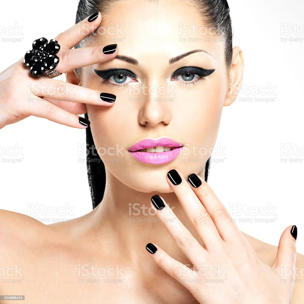 Face of the beautiful woman with black nails and pink stock photo