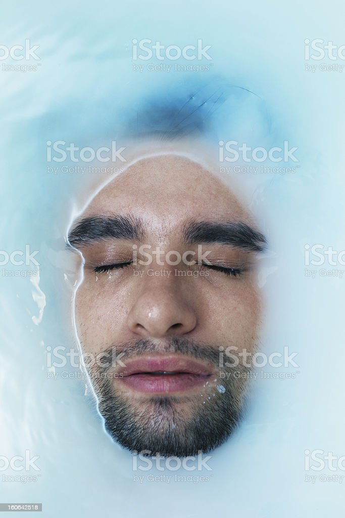 face of the young men in  muddy water royalty-free stock photo