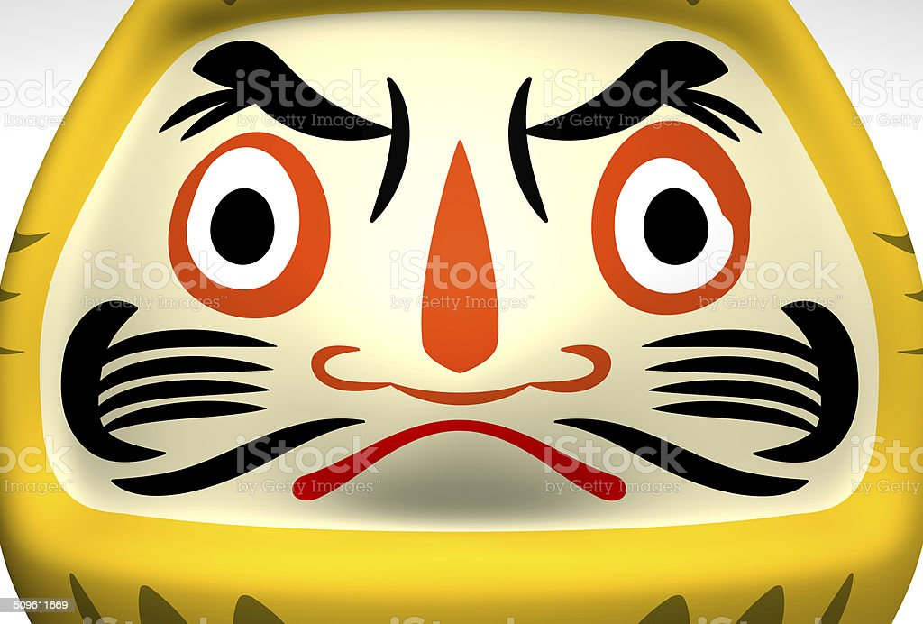 Face Of Yellow Daruma Doll stock photo