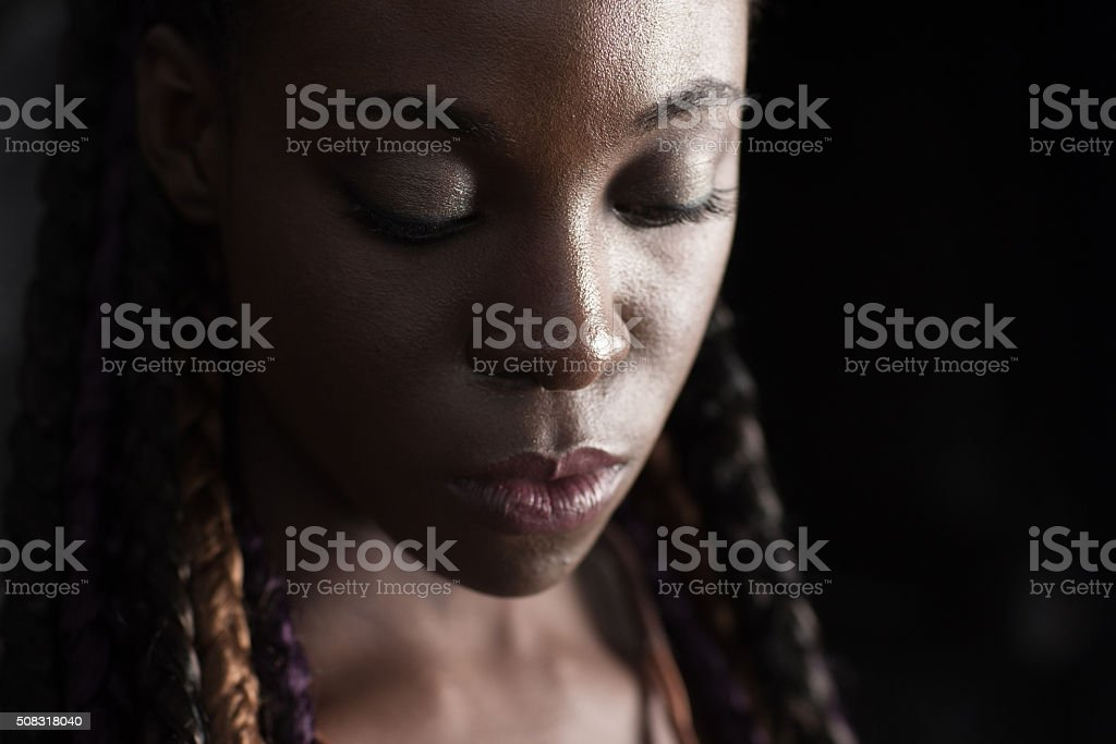 face of young afro-american braided woman stock photo