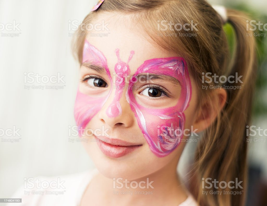 Face painted cute little girl stock photo