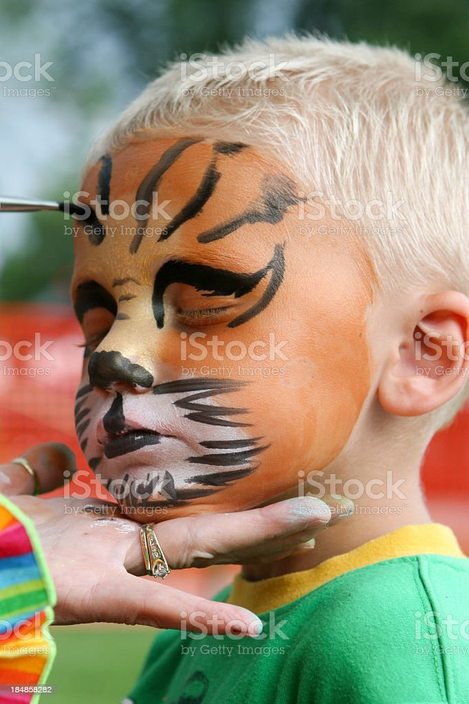 Face painted kid royalty-free stock photo