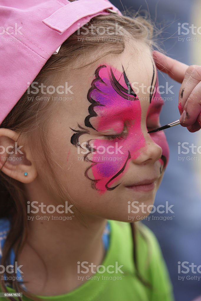 Face painting at the party. stock photo