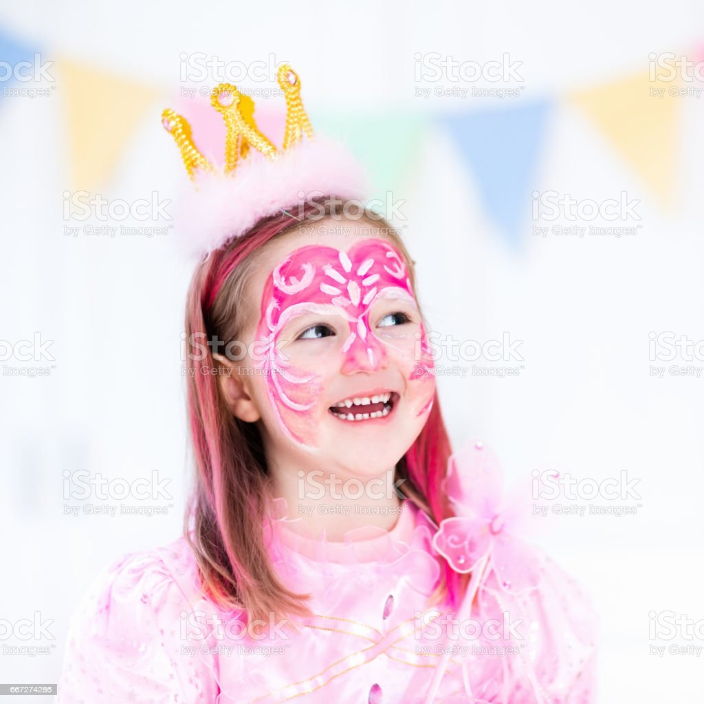 Face painting for little girl birthday party stock photo