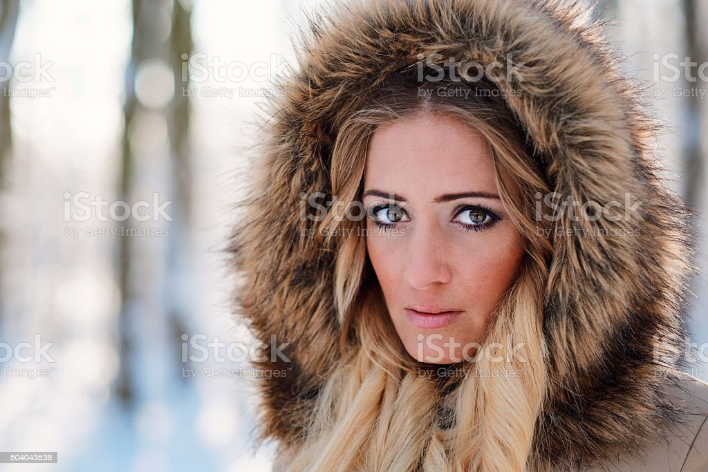 Face portrait of blonde woman with hood stock photo