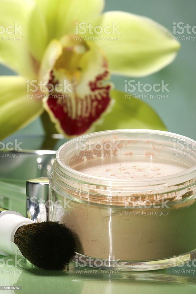 Face powder and orchid flower royalty-free stock photo