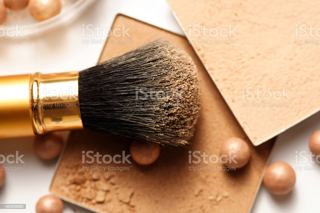 A face powder brush on top of face powder stock photo