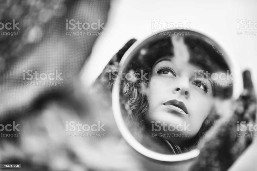 Face reflection on mirror of beautiful pensive woman stock photo