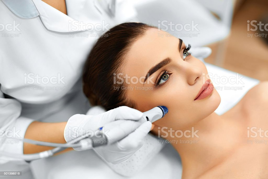 Face Skin Care. Facial Hydro Microdermabrasion Peeling Treatment stock photo