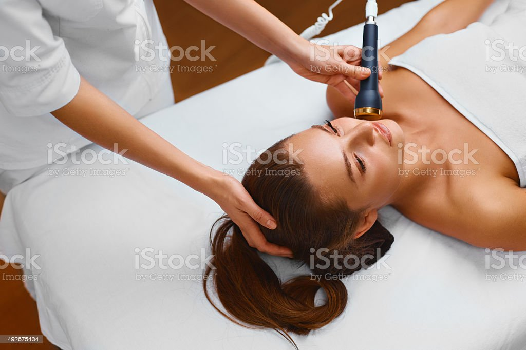 Face Skin Care. Woman in Beauty Spa Getting a Treatment stock photo