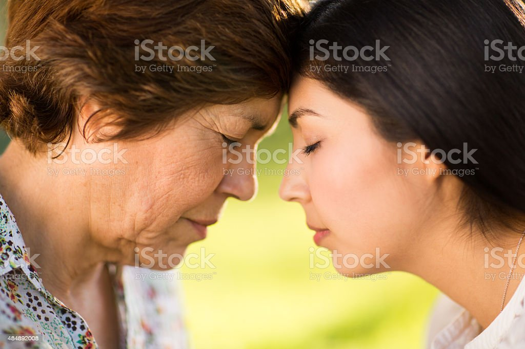 Face to face mother and daughter stock photo