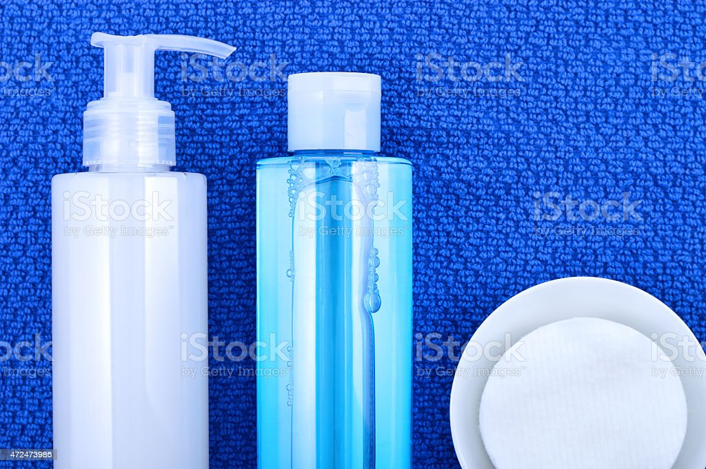Face wash cleansing gel, toner and cotton cleansing pads. stock photo