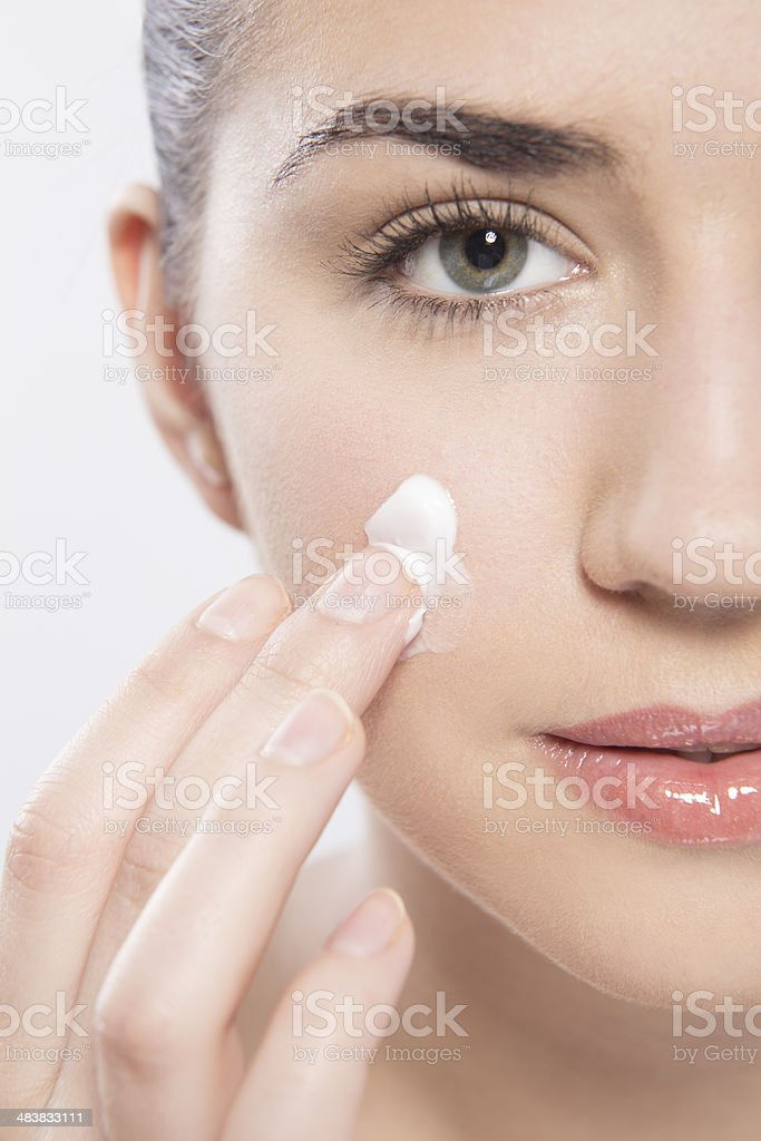 face with cream stock photo