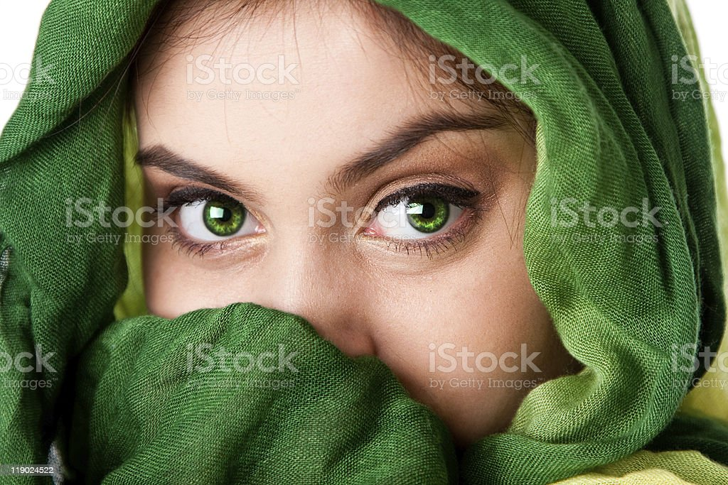 Face with green eyes and scarf royalty-free stock photo