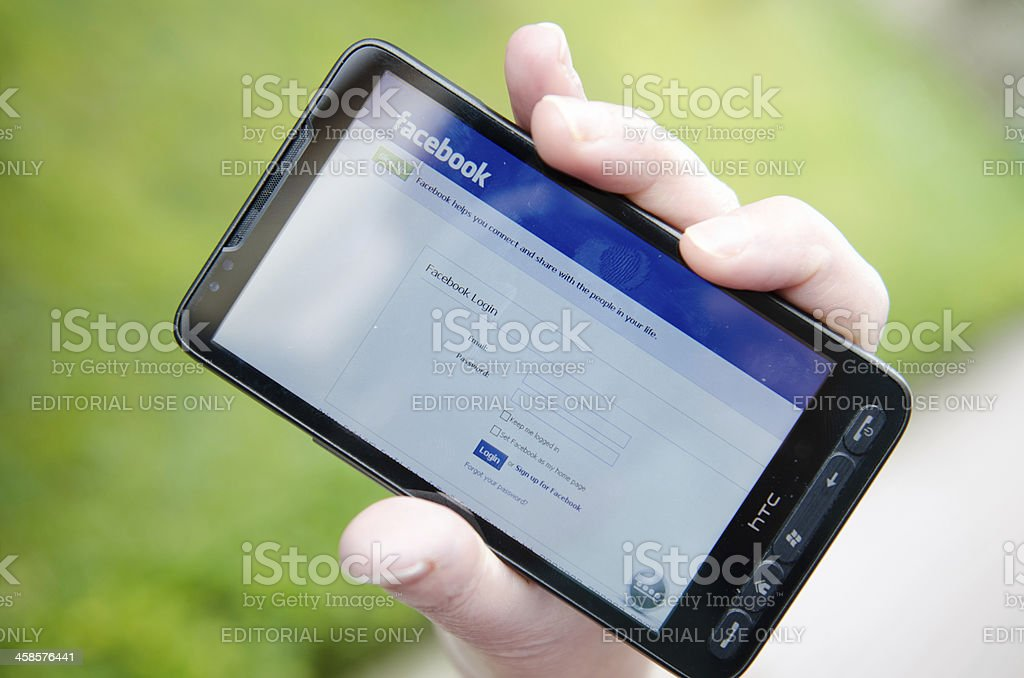 Facebook access log-ing on smarthphone royalty-free stock photo
